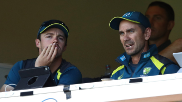 Travis Head and Justin Langer in conversation on the Australia balcony