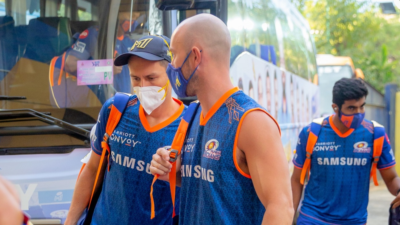 Trent Boult, Chris Lynn and Jasprit Bumrah arrive for Mumbai Indians' match against Kolkata Knight Riders