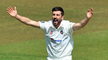 Ben Sanderson celebrates after taking a wicket
