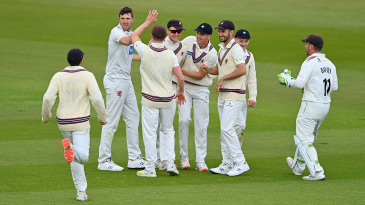 George Bartlett celebrates with his Somerset team-mates after running out Sam Northeast