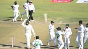 Brendan Taylor walks back in disbelief as Pakistan celebrate