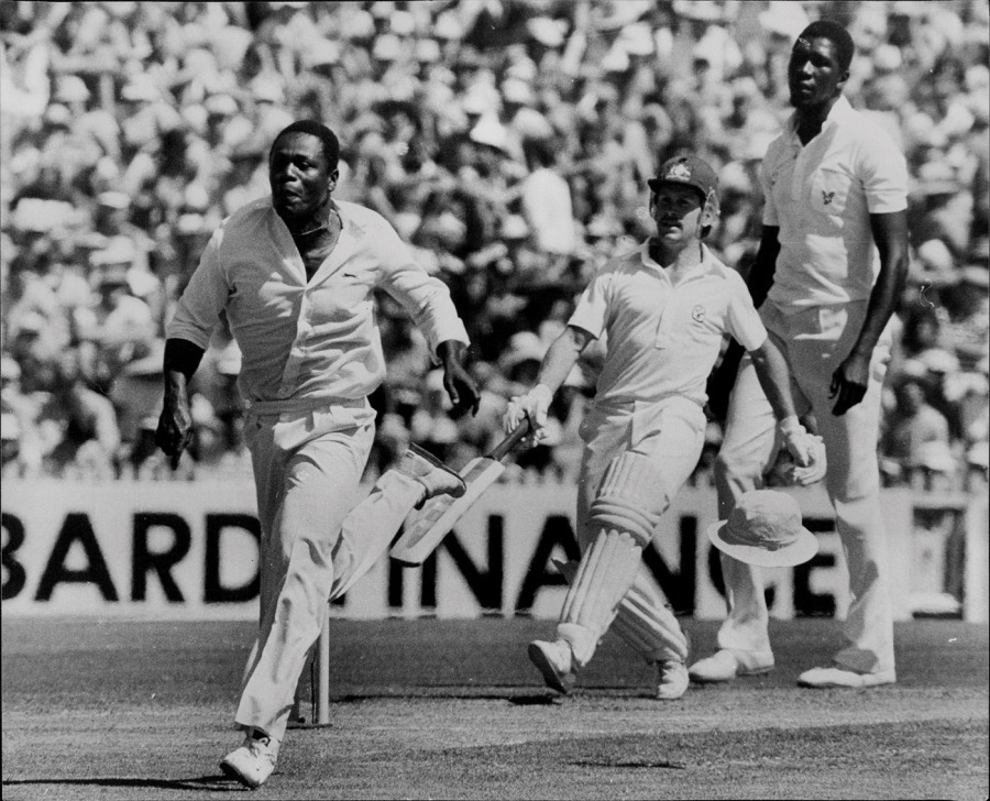 Desmond Haynes chases after a ball from Bruce Laird off the bowling of Joel Garner