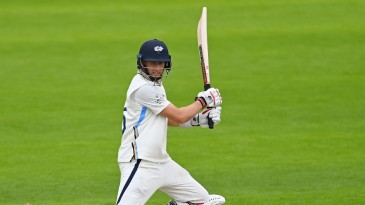 Joe Root cuts through the off side on a tough day for batting at Cardiff