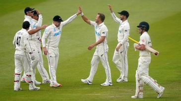 Neil Wagner celebrates with team-mates after claiming the wicket of Rory Burns