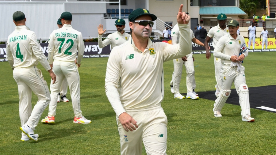 Dean Elgar leads South Africa out in his first Test as full-time captain