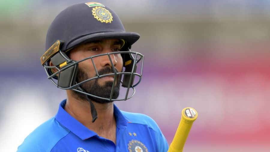 Dinesh Karthik walks off after getting out for 6