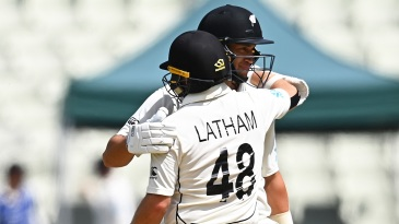Tom Latham and Ross Taylor embrace after taking New Zealand to victory