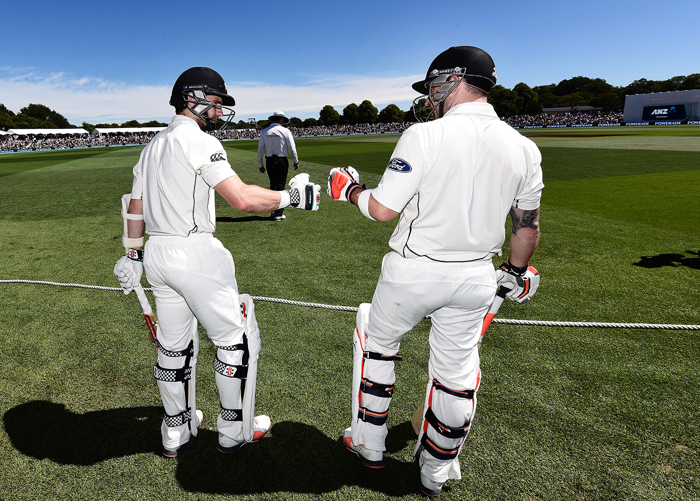 Kane Williamson and Brendon McCullum bump fists before walking out to bat