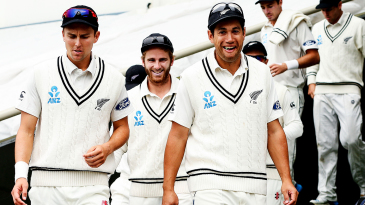 Trent Boult, Kane Williamson and Ross Taylor walk out with their team-mates