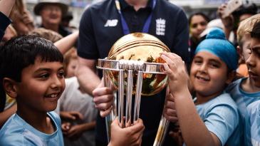 Eoin Morgan gives young fans an opportunity to get up close with the World Cup trophy
