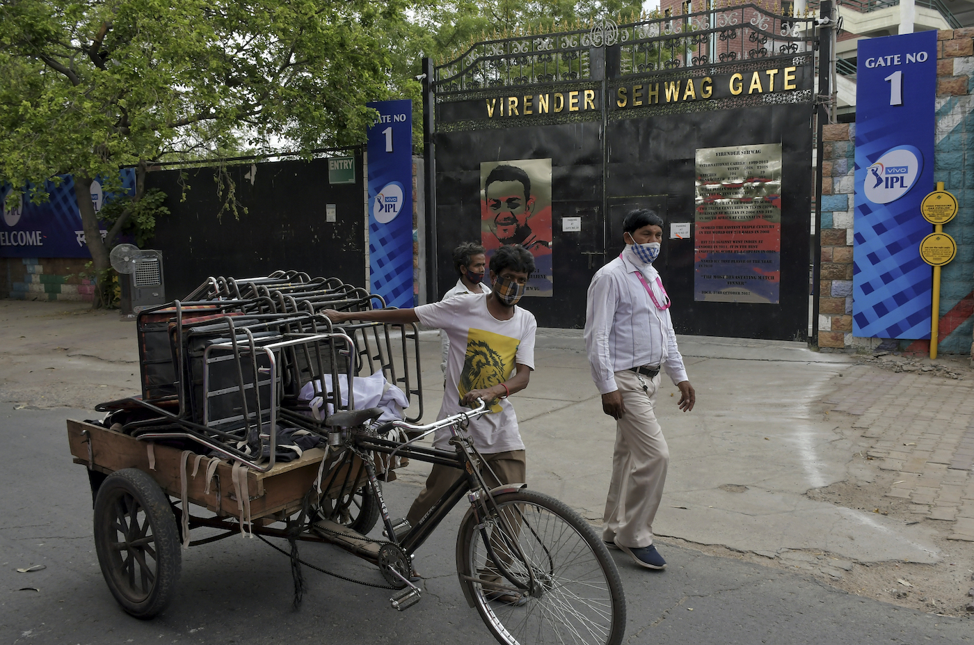 A worker carts chairs away in the wake of the cancellation of the 2021 IPL halfway through the tournament