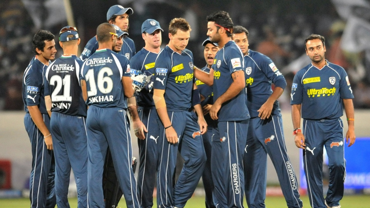 The Deccan Chargers players gather mid-pitch