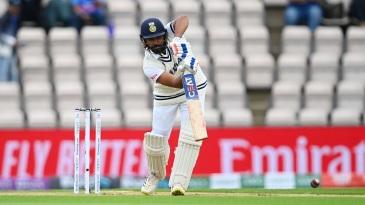 Rohit Sharma plays a straight drive
