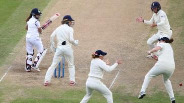 Taniya Bhatia and the England fielders watch on as Anya Shrubsole misses a chance