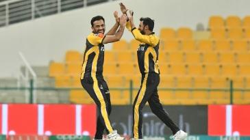 Wahab Riaz and Shoaib Malik celebrate