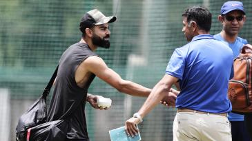 Virat Kohli shakes hands with Rahul Dravid