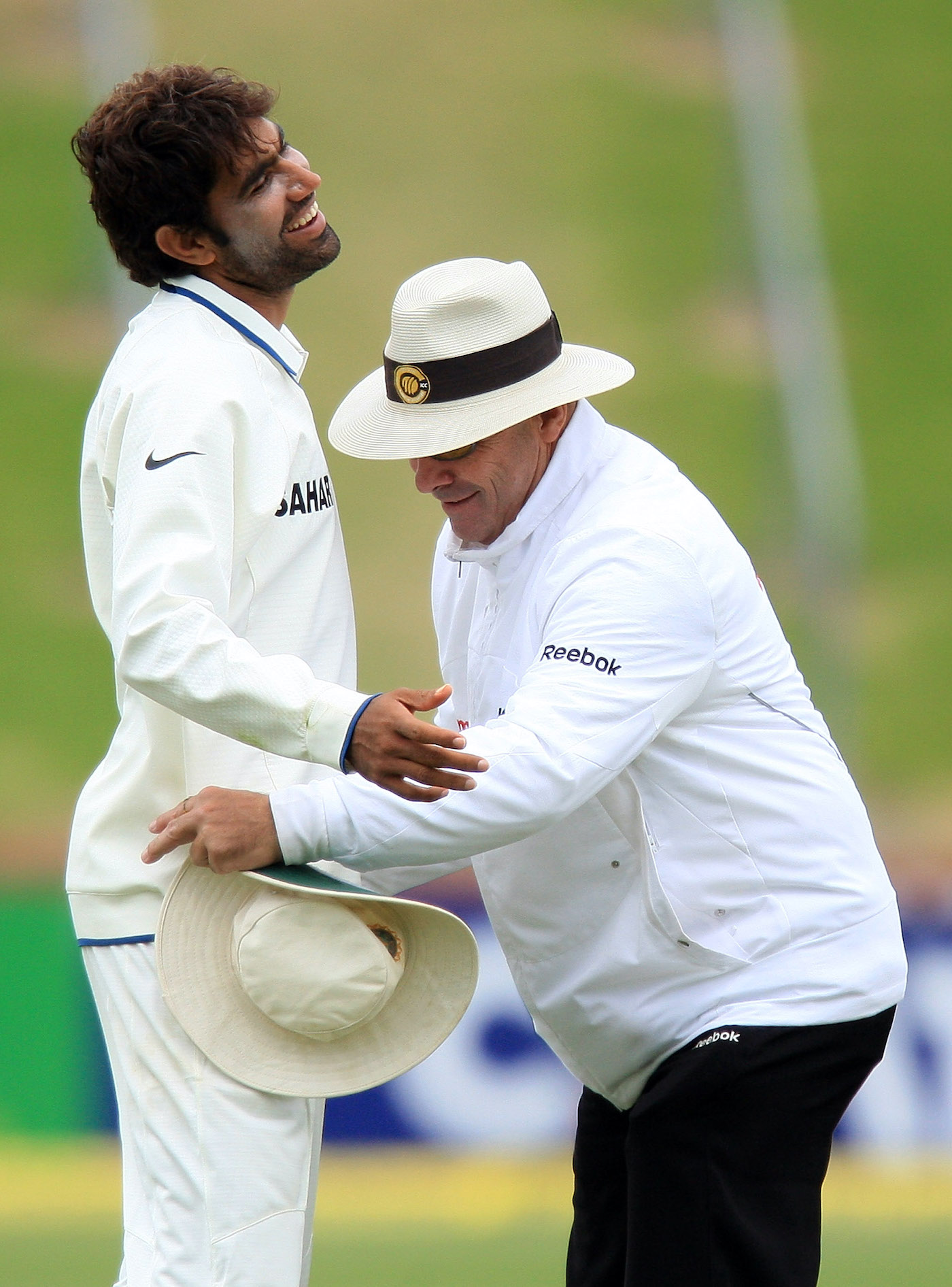 Umpire Daryl Harper gives Munaf Patel a pat-down after the ball goes missing on the final day of the Test in Wellington in 2009