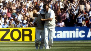 Ian Botham celebrates with Alan Knott