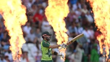 Mohammad Rizwan walks through the flames to begin his innings