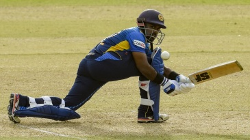 Charith Asalanka lunges forward to sweep