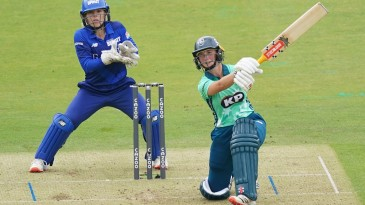Alice Capsey drives over the covers during her remarkable innings at Lord's