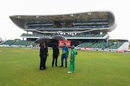 The umpires and the ground staff take shelter under an umbrella while waiting for the rain to clear , West Indies vs Pakistan, 1st T20I, Bridgetown, July 28, 2021