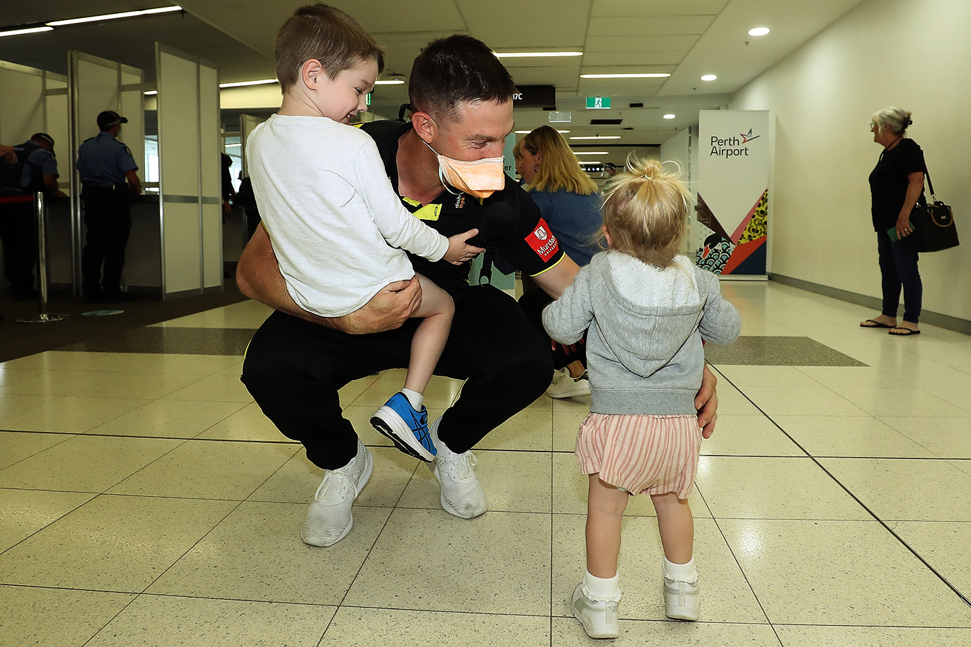 Shaun Marsh gets some time with his kids at Perth airport. Quarantine requirements have added to the amount of time players have to spend away from home