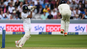 Haseeb Hameed leaps up to avoid getting hit by a KL Rahul drive