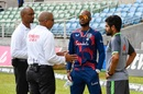 The umpires, Gregory Brathwaite and Joel Wilson, speak to rival captains Kraigg Brathwaite and Babar Azam about cancelling the day's play, West Indies vs Pakistan, 2nd Test, Jamaica, 2nd day, August 21, 2021