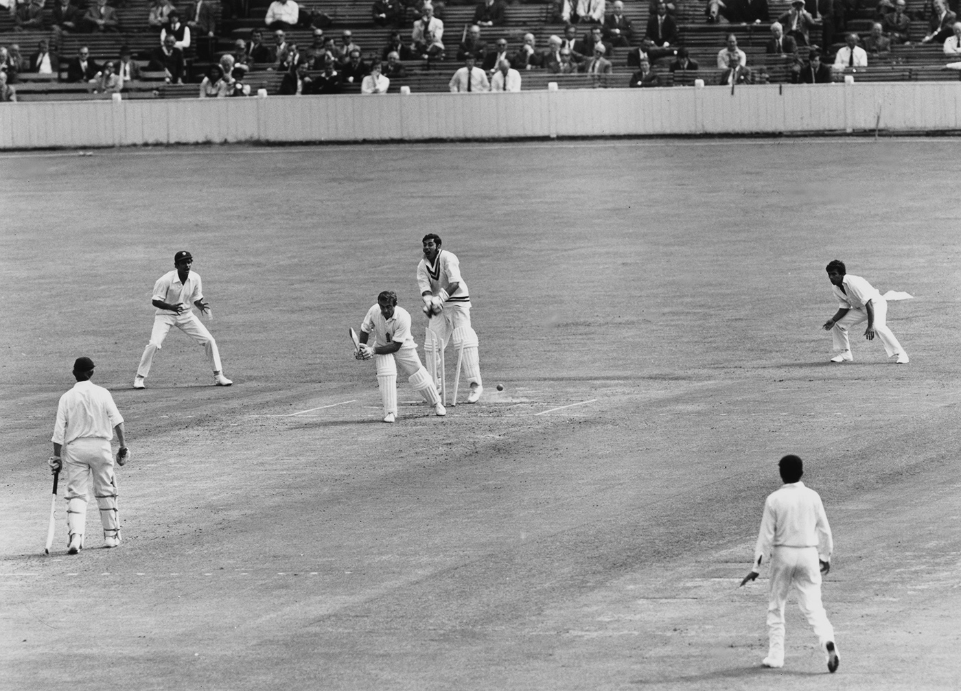 Cheer for Chandra: John Edrich becomes the first of the leggie's six victims in England's second-innings total of 101