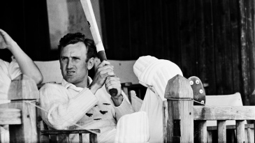 Ted Dexter sits on the verandah of the Tunbridge Wells pavilion during a county game