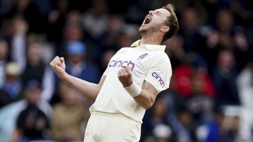 Ollie Robinson celebrates after dismissing Rohit Sharma