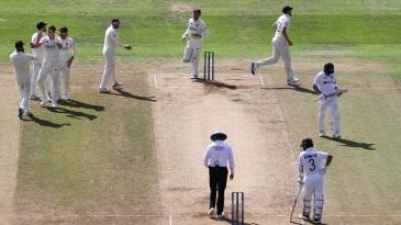 Virat Kohli walks off as England celebrate his wicket
