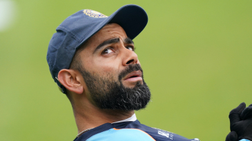 Virat Kohli warms up before the start of the fourth Test