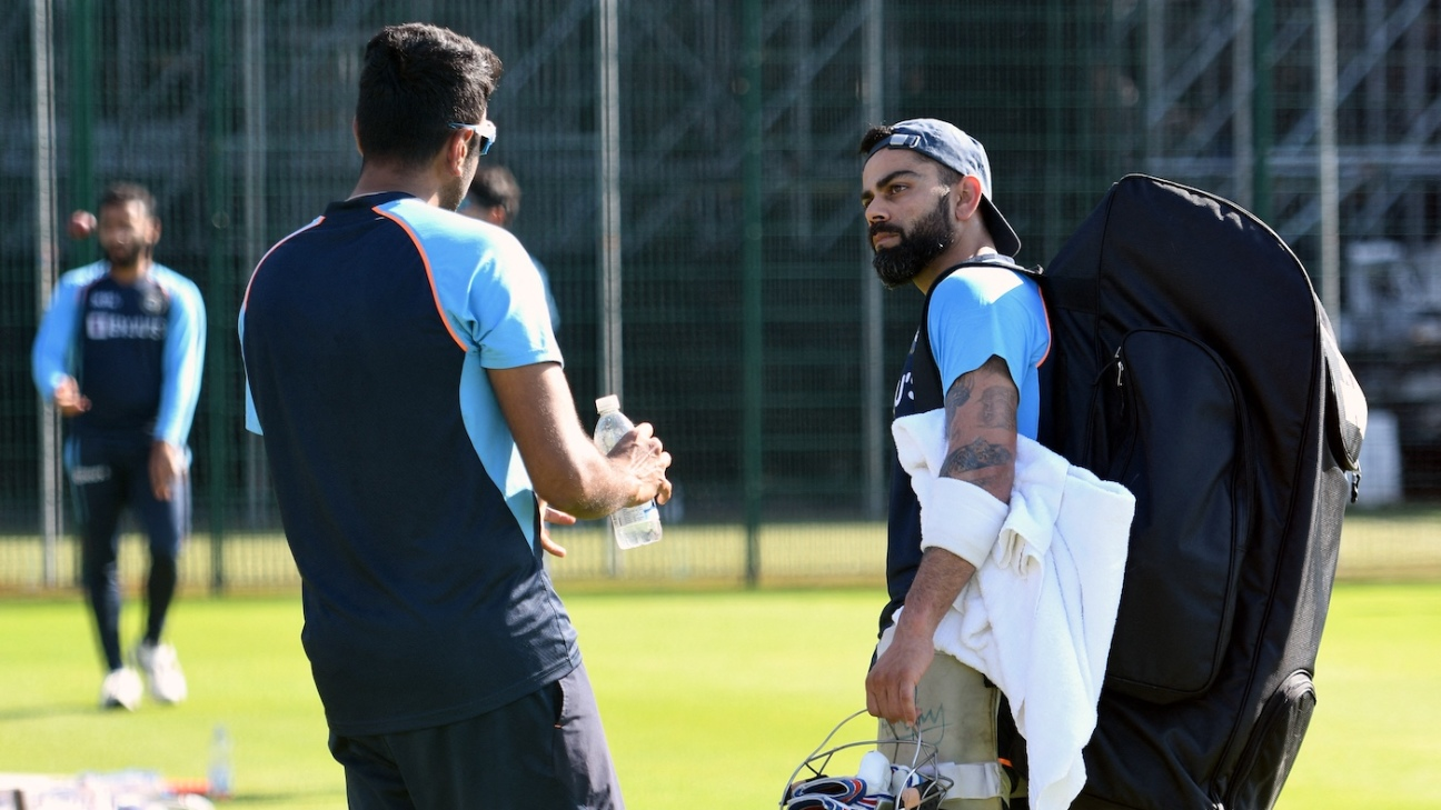 R Ashwin talks with Virat Kohli during a team practice session