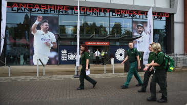 Paramedics walk past the old Trafford entrance
