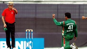 Umpire Nadir Shah raises his finger in an international match from 2008