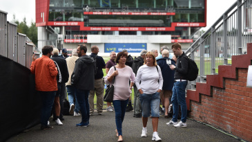 Spectators leave Old Trafford after news of the cancellation