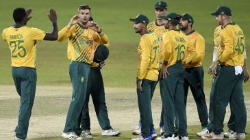 Aiden Markram celebrates with his team-mates