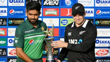 Babar Azam and Tom Latham pose with the series trophy