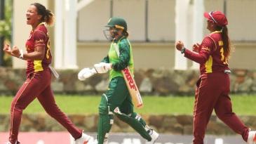 Cherry-Ann Fraser (L) celebrates her maiden ODI wicket, of Dane van Niekerk, as Mignon du Preez walks while Anisa Mohammed (R) rejoices