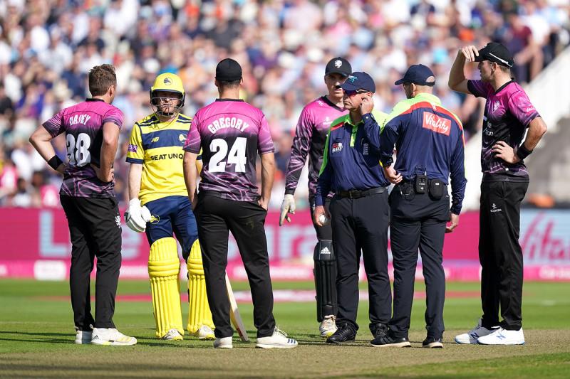 The umpires await confirmation of Joe Weatherley's reprieve