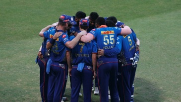 An intense pre-match huddle as Mumbai face a must-win game