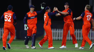 Stephan Myburgh celebrates with captain Pieter Seelaar after the fall of a wicket