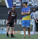 Brendon McCullum and Stephen Fleming, the two coaches, catch up before the match, Chennai Super Kings vs Kolkata Knight Riders, IPL 2021 final, Dubai, October 15, 2021