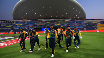 The Sri Lanka players walk out to field after the toss