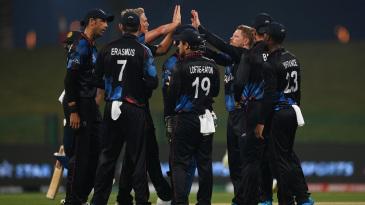 Bernard Scholtz celebrates a wicket with his team-mates