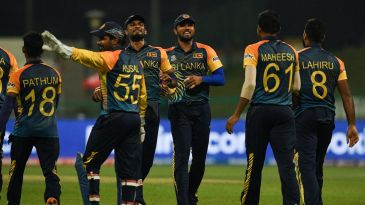 The Sri Lanka players celebrate the wicket of Kevin O'Brien