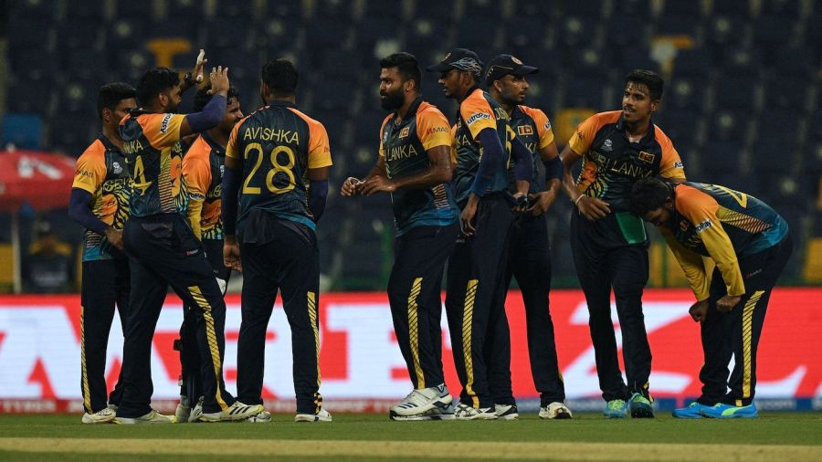 Lahiru Kumara celebrates with his team-mates after picking up a wicket