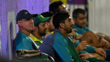 Matthew Hayden watches the warm-up game from the sidelines